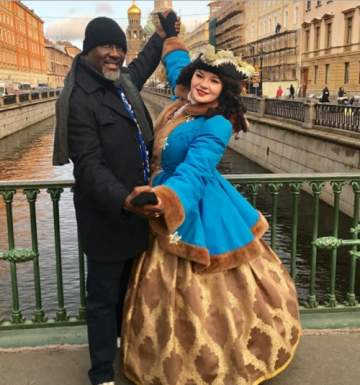 See What Senator Dino Melaye was Spotted Doing with a Pretty White Lady in Russia (Photos)