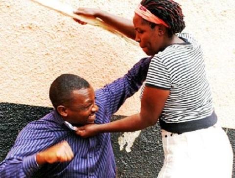 Woman Beating Man