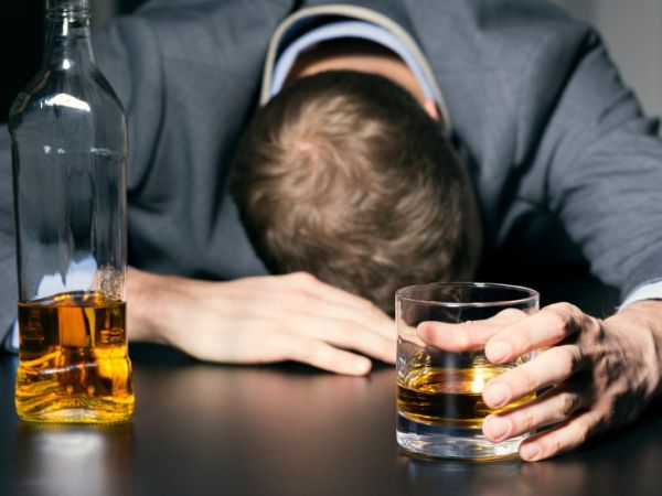 Man With Alcohol In Hand And Resting Head On Table  Thumb_0