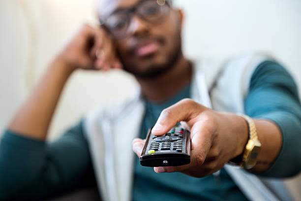 Black Man Holding Tv Remote