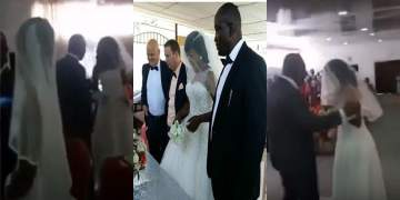Angry 'side chick' dressed in bridal gown disrupts wedding ceremony of her lover (Video)