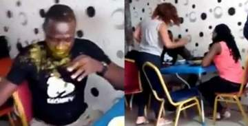 Lady slaps husband multiple times, pours soup on him for going out with side chick (Video)