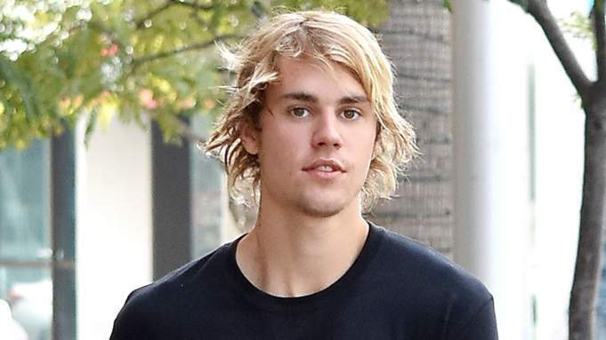 Justin Bieber reacts after being accused of sexually assaulting a woman in 2014
