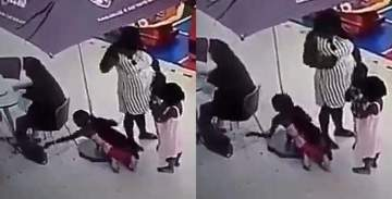Little girl caught on camera stealing a lady's bag while her mother watched (Video)
