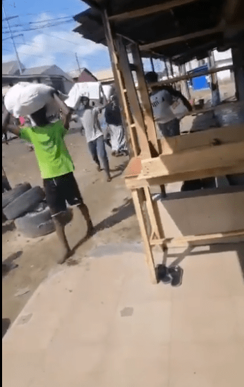 Warehouse full of COVID-19 palliatives busted and looted in Lagos (Photos/Video)