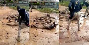 Curfew violators forced to lie in muddy water and mercilessly flogged by soldiers in Osun State (Video)