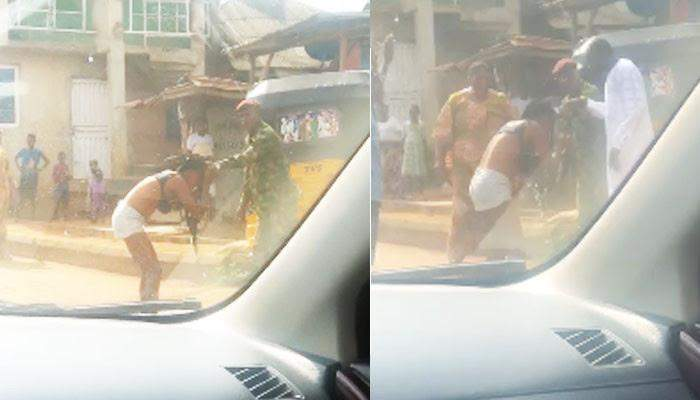 Soldier flogs, strips lady naked over 'indecent dressing' in Ogun (Video)