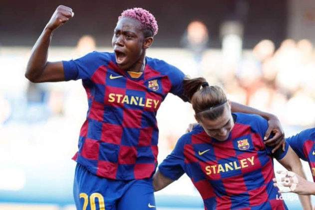 Asisat Oshoala reacts after leading Barcelona's female team to victory