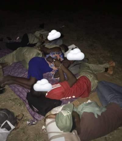Disturbing Photos Of INEC Ad-hoc Staff, Corpers Sleeping Outside Its Premises