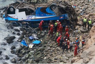 Handout picture released by Peruvian agency Andina showing rescuers, police and firefighters