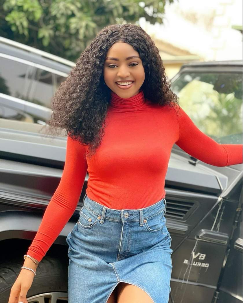 Reactions as staunch fan tattoos Regina Daniels photo on her body