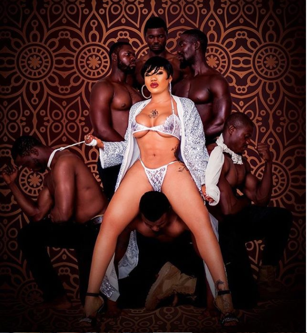 Pretty Mike Places His Head Between Toyin Lawani's Legs While Kissing Her In New Sultry Photos