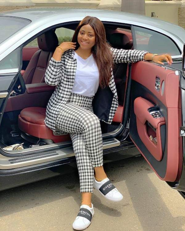 Check Out 10 Stunning Photos Of Regina Daniels Posing With Supercars