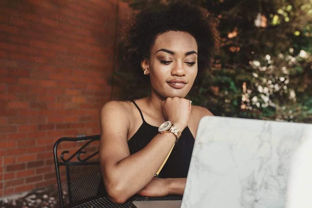 Black Woman Staring At Her Laptop