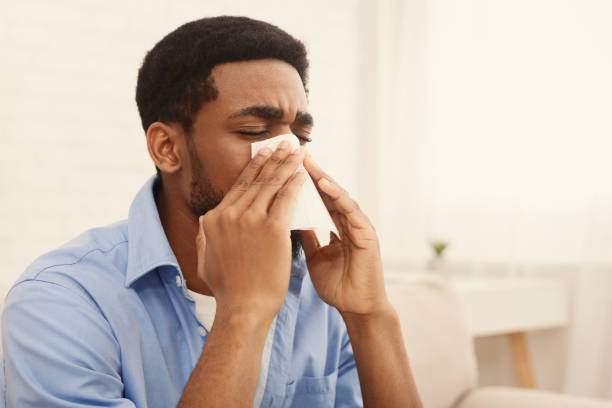 African American Man Sneezing Photo IStock
