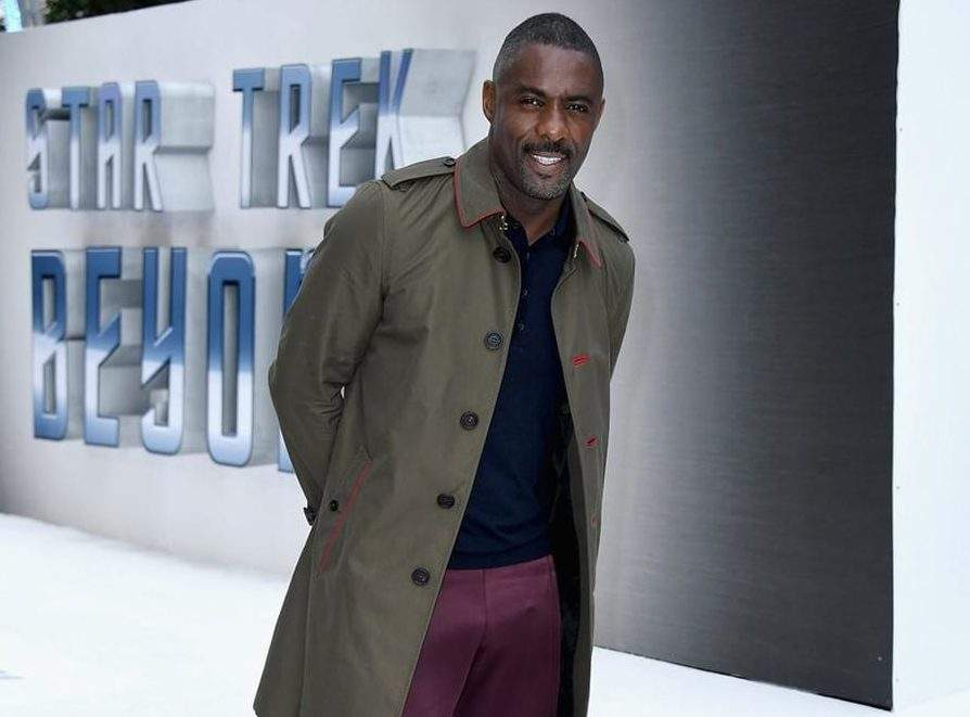 Idris Elba Wearing A Gucci Double Breasted Blue Wool Equestrian Coat Over His Outerwear Outfit Photo ManOfMany E1578816268423
