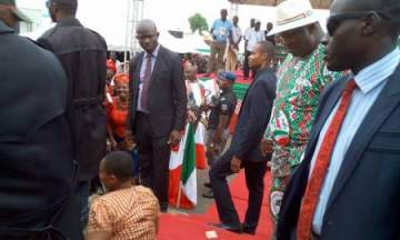 Photos: Enugu State Governor Gifts Physically Challenged Woman N1million Cash