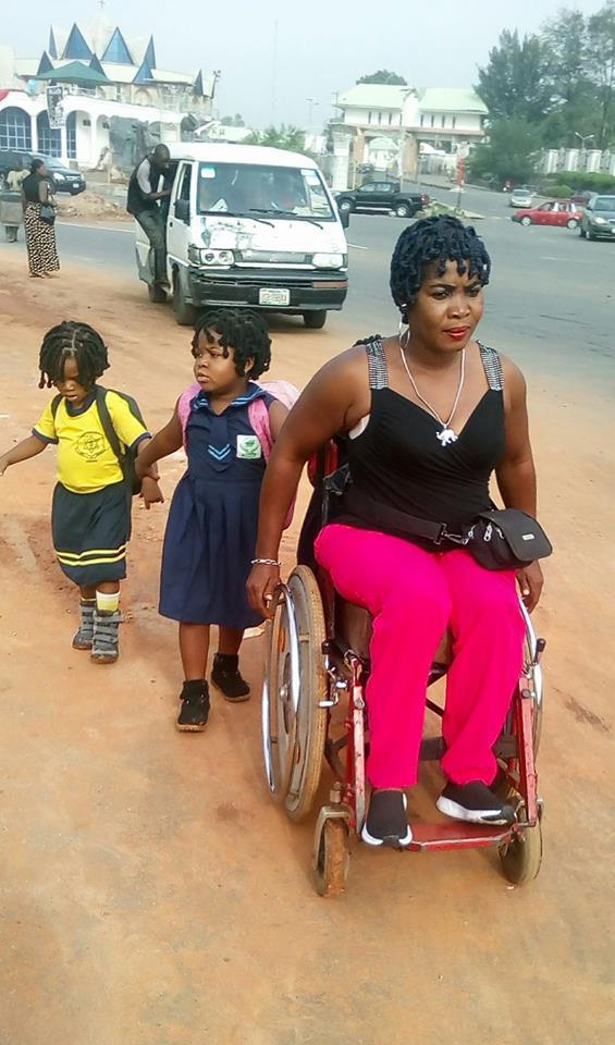 Emotional Photo Of Physically Challenged Nigerian Mother Taking Her 3 Kids To School