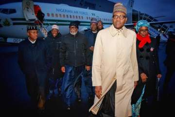 This Photo Of Buhari And His Aides' Arrival At Paris Has Got A Lot Of People Talking.