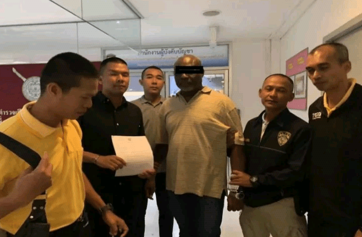 Wanted Nigerian fraudster arrested in Thailand as he arrives Immigration office to extend his visa (Photos)