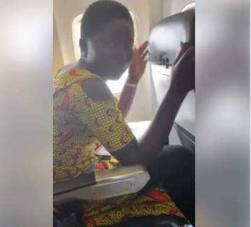 Girl on her first flight Bursts Into Tears After Looking Through The Window.