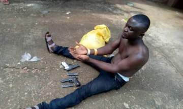 Man Nabbed At Obudu Motor Park With Pistols And Magazines Buried In A Bag Of Garri (Photos)