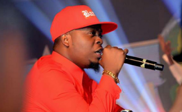Don't Drop Out Of School To Fulfill Your Dreams, Olamide Advises