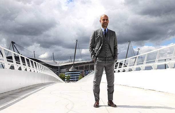 Manchester Citys Manager Pep Guardiola Poses For Photographs Outside Picture Id545519086?k=6&m=545519086&s=&w=0&h=zt6PvsaOE5V2pAK9SaMAMVePWycSuJ4BLbaCoYtbZeo=