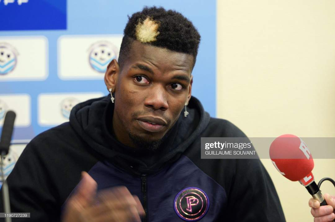 Manchester United And France Midfielder Paul Pogba Gives A Press A Picture Id1190727239?s=28