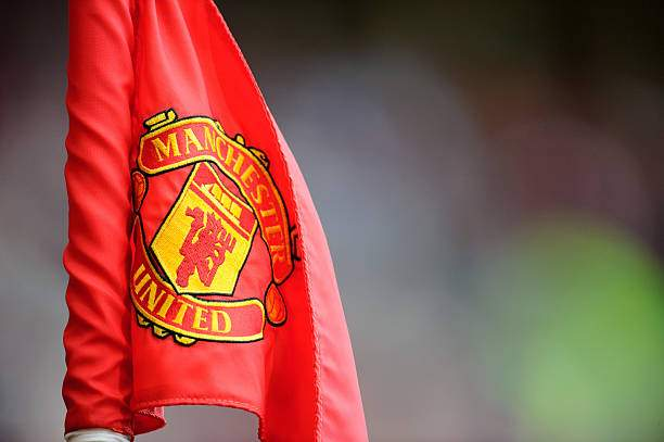 Manchester United Badge Logo On Corner Flag Picture Id594790796?k=6&m=594790796&s=&w=0&h=OlcrBkUzrBt0NYl_2TDpiAmdAgHoV5W5Va4G90Tw87Q=