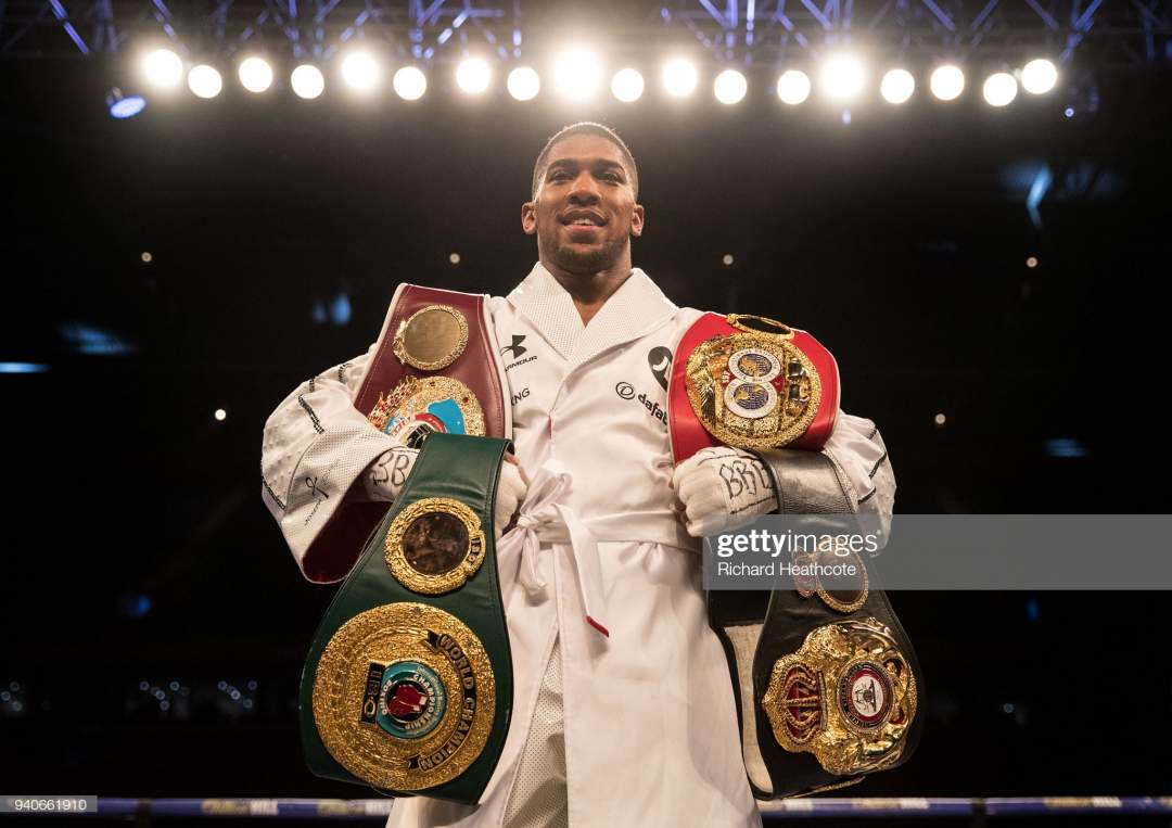 Anthony Joshua Poses With His Belts After His Wba Ibf Wbo Ibo Title Picture Id940661910?s=28
