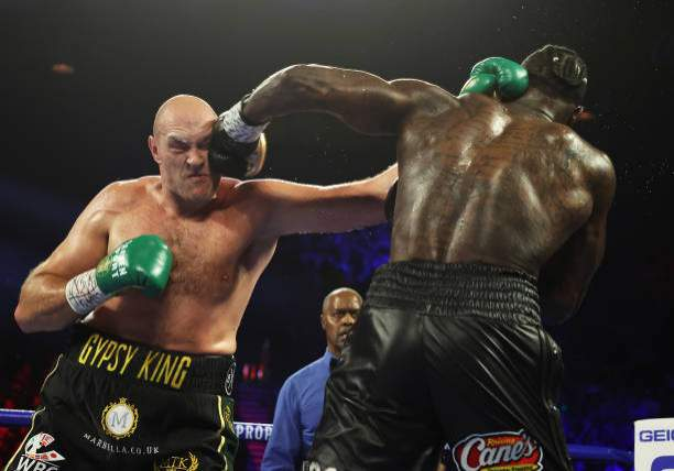 Deontay Wilder Punches Tyson Fury During Their Heavyweight Bout For Picture Id1208428665?k=6&m=1208428665&s=&w=0&h=wj0_Y59OR9q_uexW8oA6ai ZZQ2M A8uxr0PSTjCT1s=