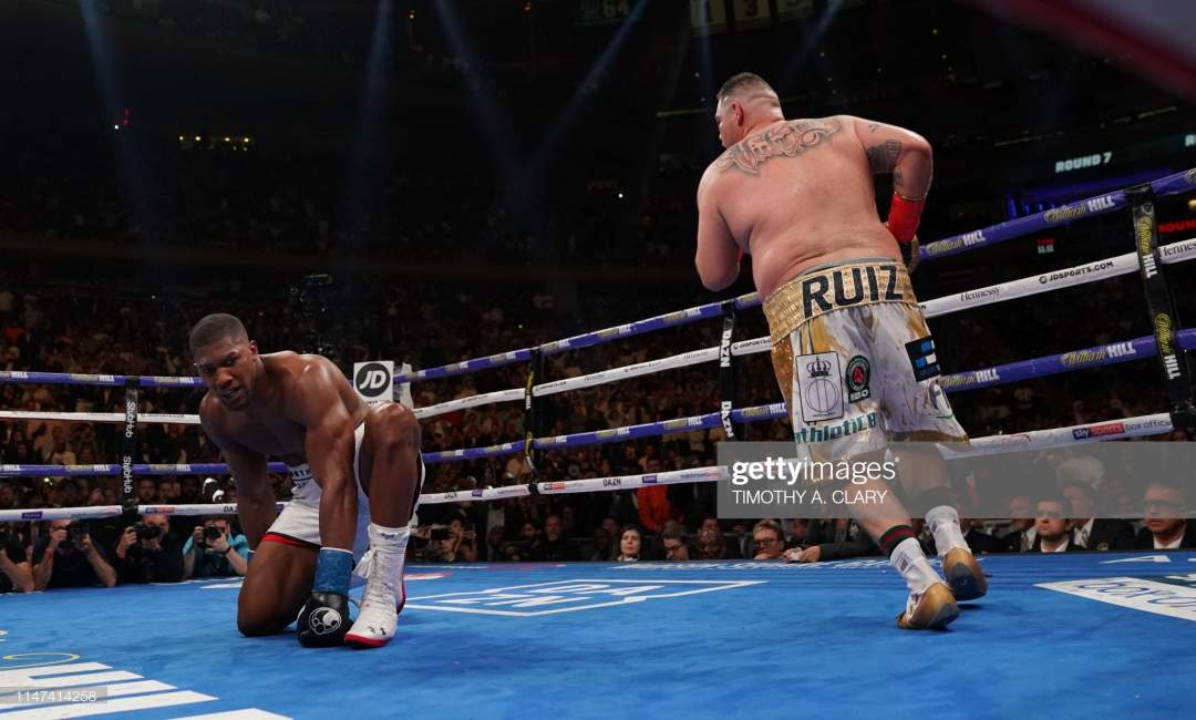 Englands Anthony Joshua Kneels After Being Knocked Down By Usas Andy Picture Id1147414258?s=28
