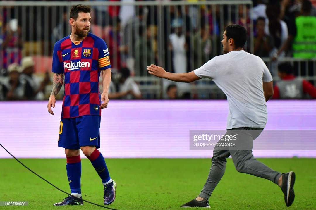 Fan Rushes Towards Barcelonas Argentine Forward Lionel Messi The Picture Id1192758620?s=28