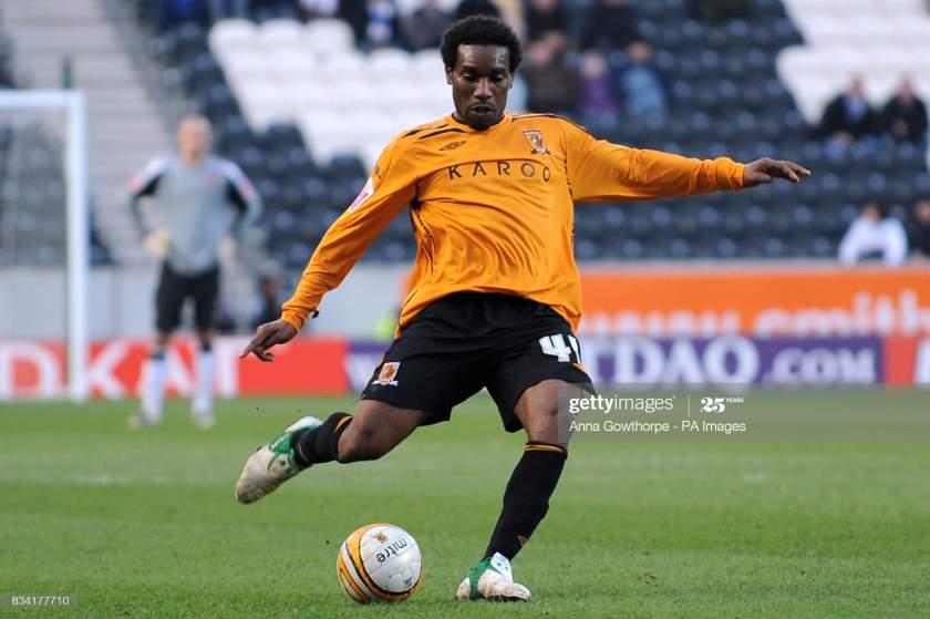Hull Citys Jayjay Okocha Sweeps A Free Kick Into The Box Where An Picture Id834177710?s=28