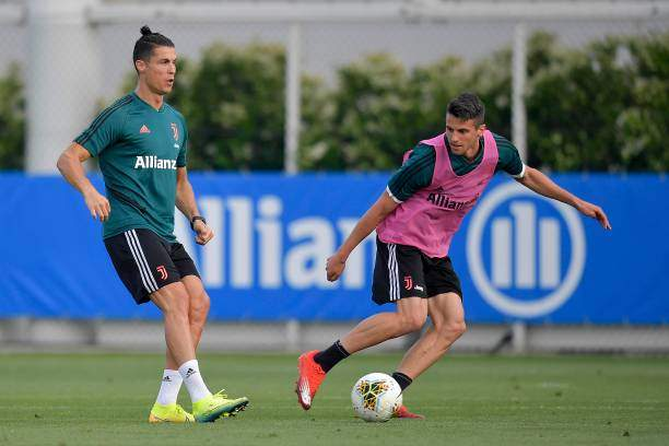 Juventus Players Cristiano Ronaldo And Luca Coccolo During A Training Picture Id1240233739?k=6&m=1240233739&s=&w=0&h=AwA742MkSaBp 2Dyyo_SPghZP2MGKXKXJuQLT6c26dc=