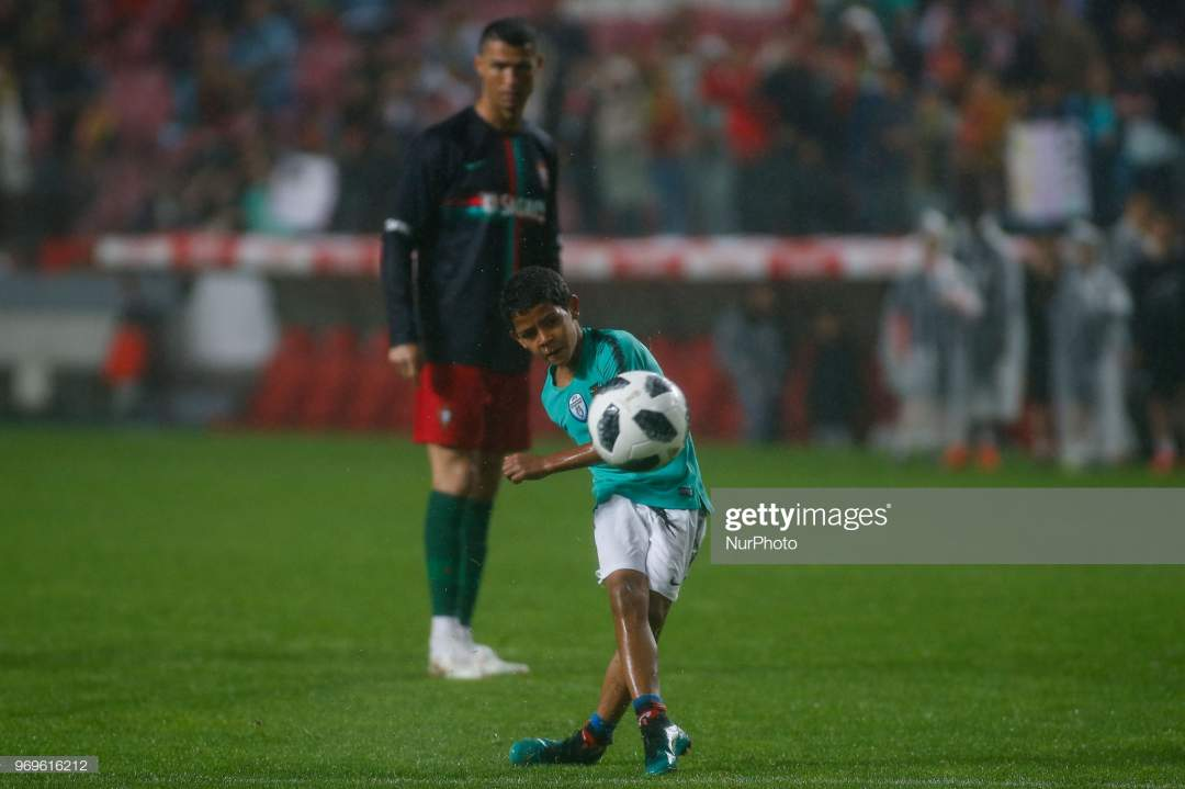 Portugal Forward Cristiano Ronaldo Son Cristianinho Plays With Is At Picture Id969616212?s=28