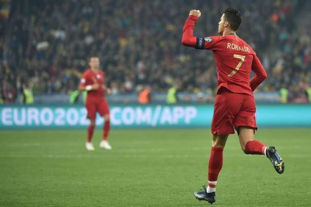 Portugals Forward Cristiano Ronaldo Celebrates After Scoring A Goal Picture Id1175976464?k=6&m=1175976464&s=&w=0&h=j9QV8mFGfmsnznlbCMf7sTrobTSdTbEZ3zb1YX4NA0I=