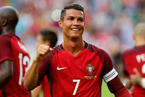 Portugals Forward Cristiano Ronaldo Celebrates After Scoring A Goal Picture Id538941338?k=6&m=538941338&s=&w=0&h=g6I76VcuetaO_KH2hE OiMtP3kwwbj5_NA9UVULWuaA=