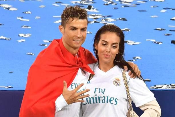 Real Madrids Portuguese Forward Cristiano Ronaldo Poses With His Picture Id962801116?k=6&m=962801116&s=&w=0&h=e85tRbfrvY0jbB1vFLOji8i_OLtkM2QFld6TXq7byE0=