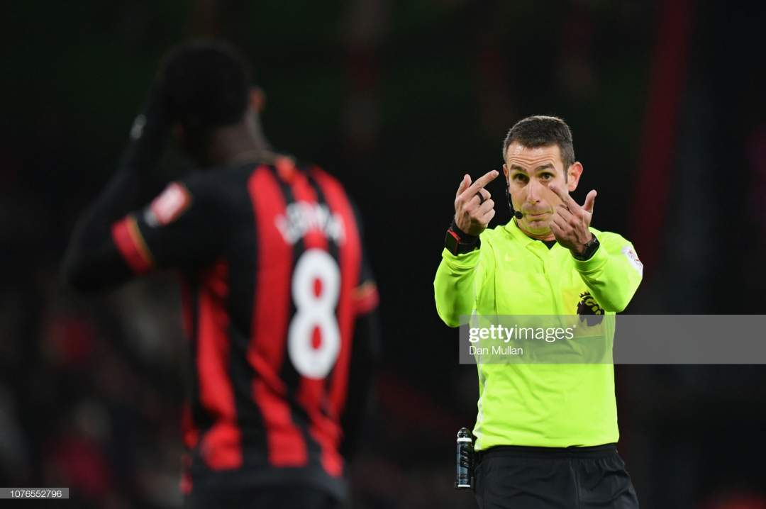 Referee David Coote Signals To Jefferson Lerma Of Afc Bournemouth Picture Id1076552796?s=28