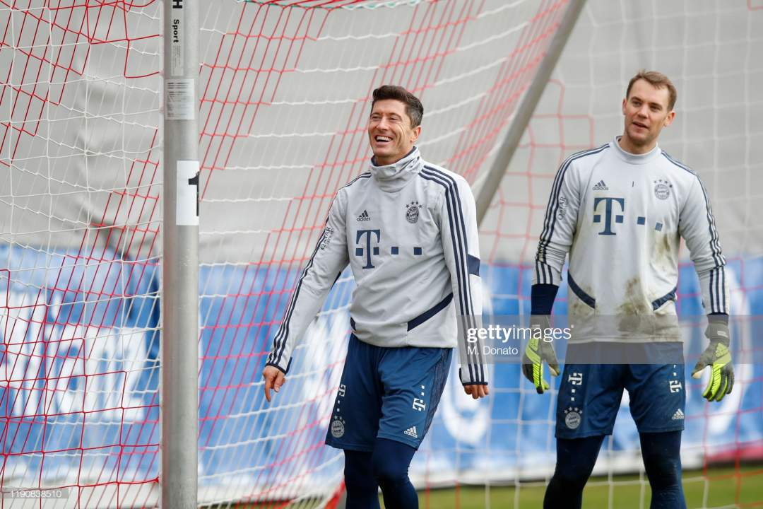 Robert Lewandowksi And Manuel Neuer Of Fc Bayern Muenchen Look On A Picture Id1190838510?s=28