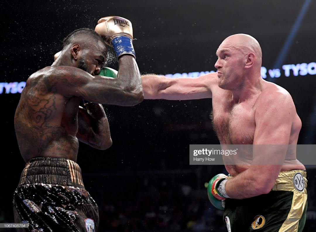 Tyson Fury Punches Deontay Wilde In The Seventh Round Fighting To A Picture Id1067405754?s=28