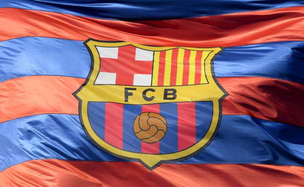 The Barcelona Logo Is Seen On A Flag Waving Above The Stadium Prior Picture Id941920690?k=6&m=941920690&s=&w=0&h=_ba8tM8tT4KncahImNoCpKsYxtaFDA7t 8mi_lYsXFQ=