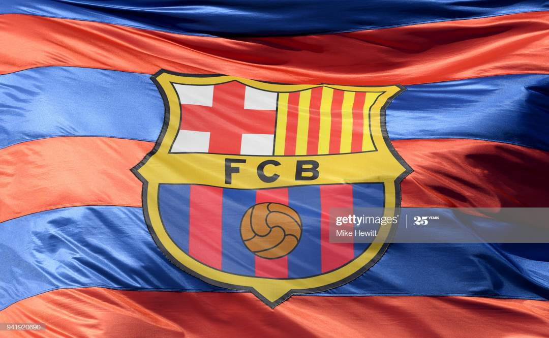 The Barcelona Logo Is Seen On A Flag Waving Above The Stadium Prior Picture Id941920690?s=28