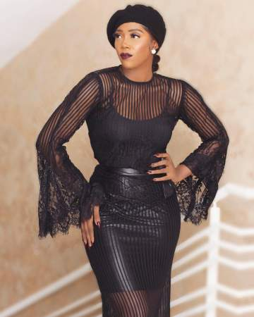 Tiwa Savage Looking Good In Net Gown And Oliver Twist Cap (Photo)