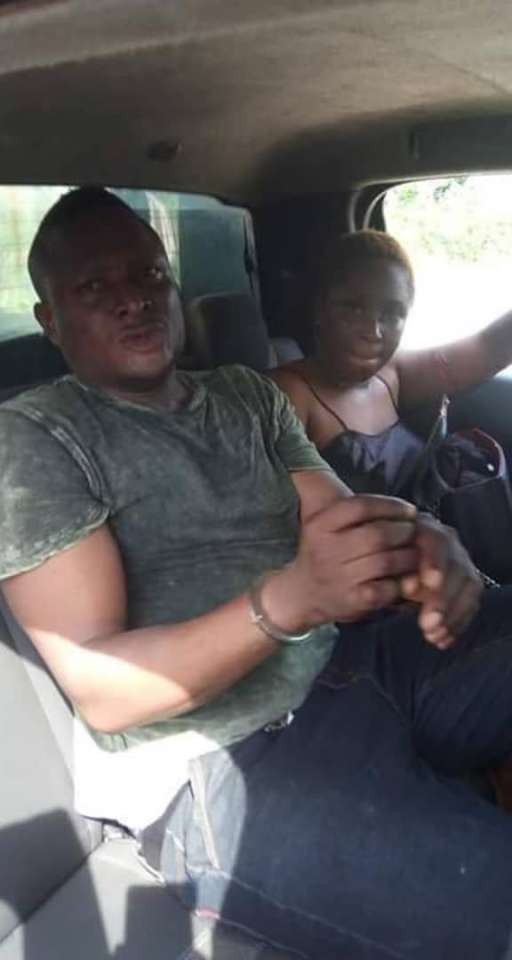 A lady occupies the backseat of a vehicle alongside a man thought to have attempted to kill her. (Tatafo Naija)