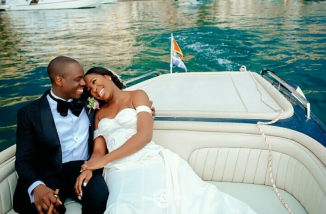 The happy couple from #omgwedding relax on a boat in Montenegro and the bride is wearing her stunning Andrea Iyamah wedding gown. (Instagram/ @misudoh)